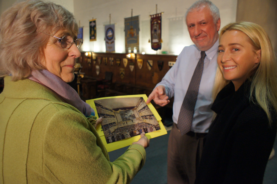 Malcolm Toogood shows Asher Keddie the picture guides use to show the interior of the theatre